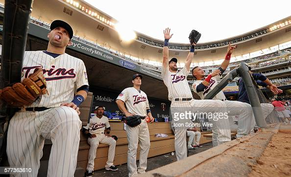 Minnesota Twins right fielder Oswaldo Arcia far right third baseman Trevor Plouffe right pose for the Fox Sports North television crew as left...