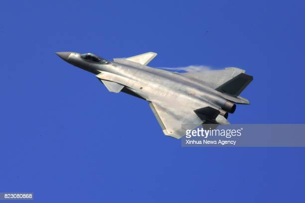 File photo taken on Nov 1 2016 shows China's domesticbuilt J20 stealth fighter flying at the 11th China International Aviation and Aerospace...