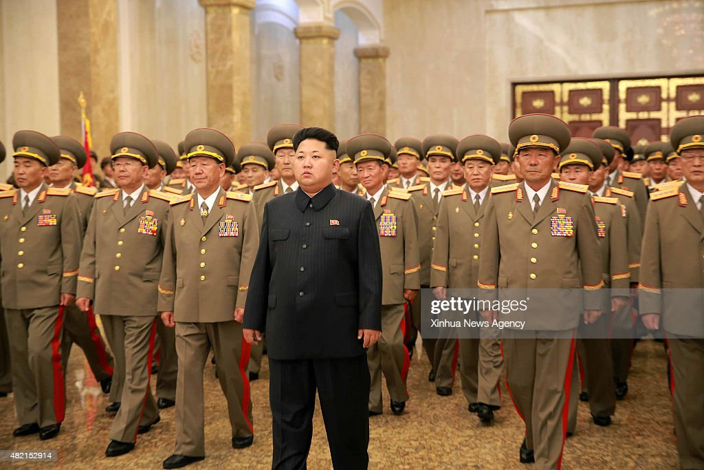 PYONGYANG, July 27, 2015-- Photo provided by Korean Central News Agency on July 27, 2015 shows top leader of the Democratic People's Republic of Korea Kim Jong Un, center, visiting the Kumsusan Palace of the Sun on the occasion of the 62nd anniversary of the Korean War armistice, July 27. The chief of the guard of honor of the Korean People's Army Ground, Naval, Air and Anti-Air Forces and the Worker-Peasant Red Guards made a salute towards the statues of late leader Kim Il Sung and Kim Jong Il. Placed at the statues were a floral basket in the name of Kim Jong Un and a floral basket in the name of the KPA. Kim Jong Un, together with other visitors, paid tribute to the statues of Kim Il Sung and Kim Jong Il.