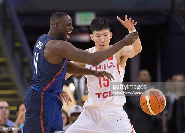 OAKLAND July 27 2016 Zhou Qi right of China vies with Draymond Green of the USA during a friendly match at the Oracle Arena in Oakland California the...