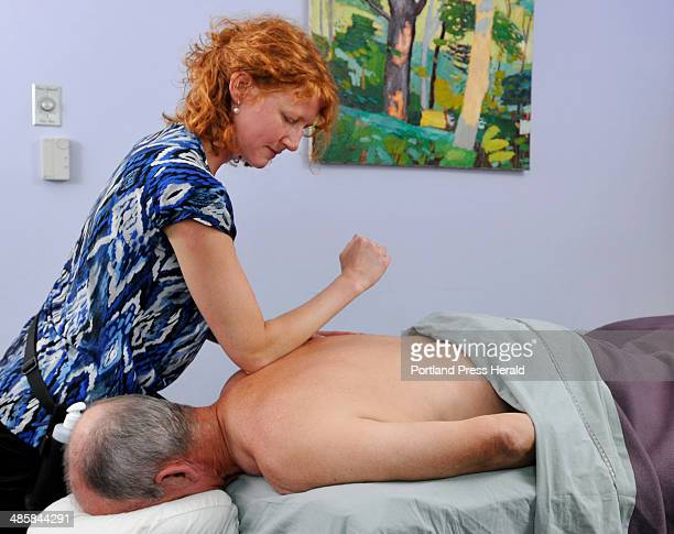 PHOTOGRAPHER July 28 2008 Melissa Williamson LMT a Massage Therapist at True North in Falmouth treats a client from the Boomer Years he's sixty He...