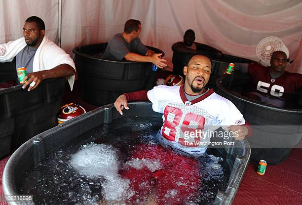 Redskins WR Santana Moss lets out a sigh as he dips in the ice bath following their first workout of training camp on July 29 2010 in Ashburn Va...