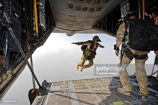 July 30, 2012 - A U.S. Air Force pararescueman jumps out of the back of an HC-130P Combat King aircraft over the Grand Bara Desert, Djibouti.