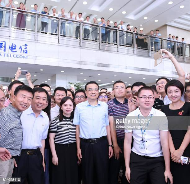 BEIJING July 31 2017 Chinese Premier Li Keqiang poses for group photos with staff of China Telecom in Beijing capital of China July 31 2017 Li...