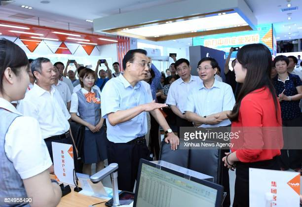 BEIJING July 31 2017 Chinese Premier Li Keqiang visits a business hall of China Unicom in Beijing capital of China July 31 2017 Li visited the...