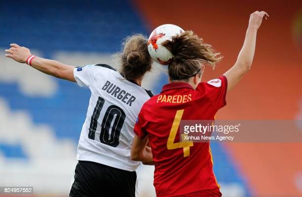 TILBURG July 31 2017 Nina Burger of Austria heads the ball with Irene Paredes of Spain during the UEFA Women's EURO 2017 soccer tournament...