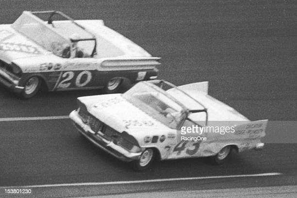 Richard Petty races his 1959 Plymouth convertible alongside the 1957 Mercury convertible of Benny Rakestraw during the Firecracker 250 NASCAR Cup...