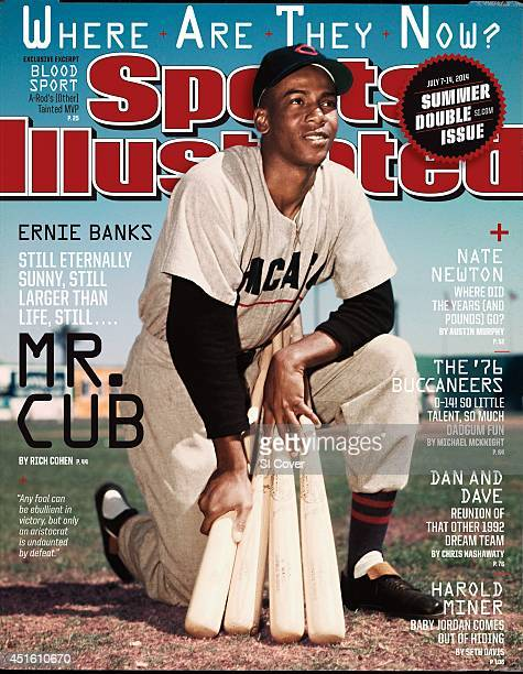 Baseball Where Are They Now Portrait of Chicago Cubs Ernie Banks kneeling on field while holding bats during photo shoot before spring training game...