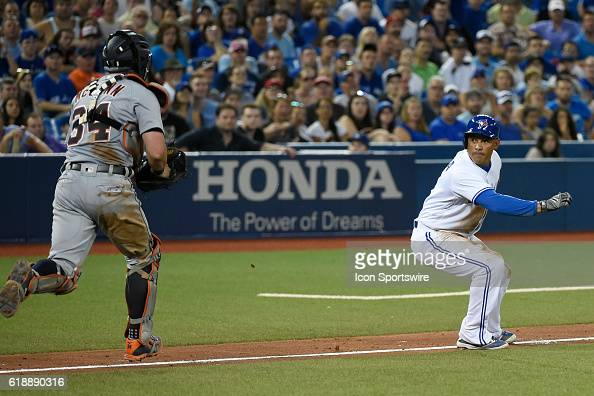 Toronto Blue Jays Outfield Ezequiel Carrera [6908] is chased in a rundown by Detroit Tigers Catcher James McCann [9679] during the game between the...