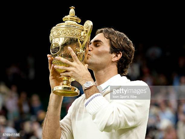 July 8 2012 Roger Federer of Switzerland kisses the trophy after defeating Andy Murray of Great Britain and claiming men's singles title at the...