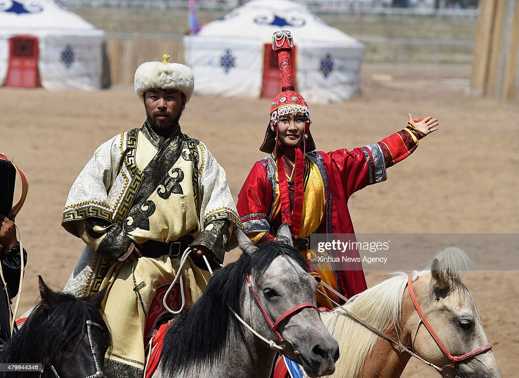 HOHHOT July 8 2015 Artists perform in a race course in Hohhot capital of north China's Inner Mongolia Autonomous Region July 8 2015 A live...