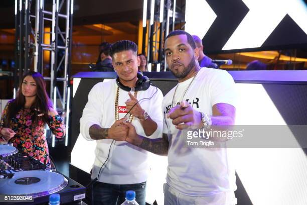 Lloyd Banks and DJ Pauly D perform at The Pool After Dark at Harrah's Resort on Saturday July 8 2017 in Atlantic City New Jersey
