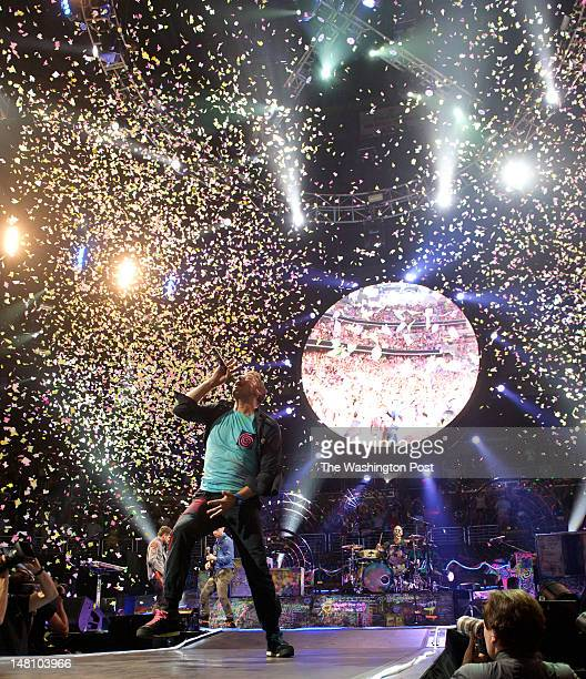 WASHINGTON DC July 9th 2012 Coldplay perform as confetti cannons spray at the Verizon Center in Washington DC The band's 2011 album Mylo Xyloto...