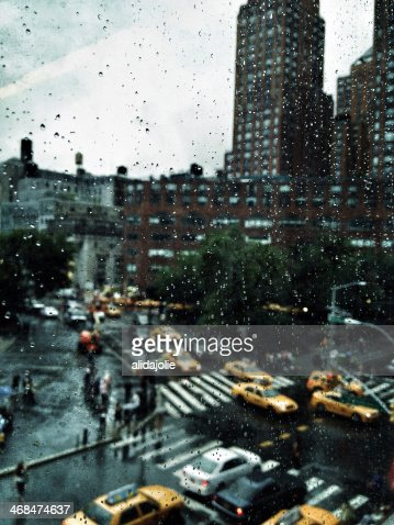 july, rain, and yellow cabs : Stock Photo