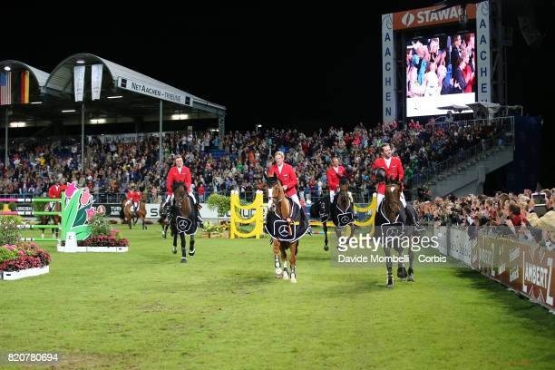 The German team Maurice Tebbel riding Chaccos Son Marco Kutscher riding CLENUR Marcus Ehning riding Pret A Tout Philipp Weishaupt riding LB Convall...