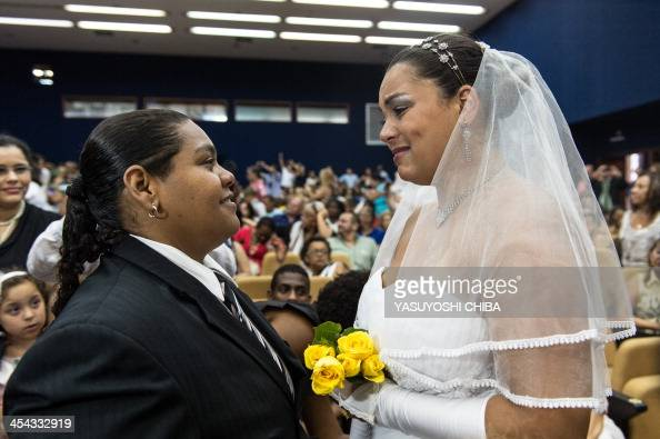 Jumana and Ana Paula take marriage vows during their wedding ceremony at the Court of Justice of the State of Rio de Janeiro on December 8 2013 130...
