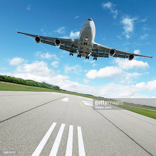 XL jumbo jet airplane landing on runway