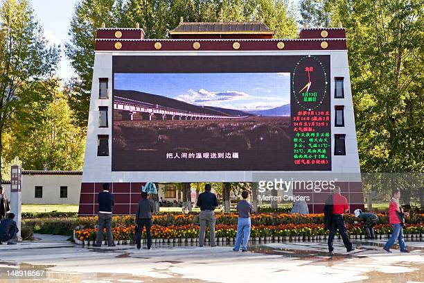 Jumbotron on Potala Square showing trans Tibetan railway construction video clips.