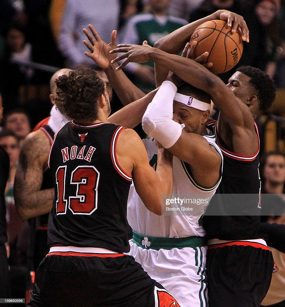 A jump ball was called as Boston Celtics small forward Paul Pierce (#34) was wrapped up by Chicago Bulls center Joakim Noah (#13) and Chicago Bulls small forward Jimmy Butler (#21) late in the fourth quarter as the Boston Celtics play the Chicago Bulls at TD Garden.
