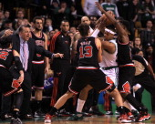 A jump ball was called as Boston Celtics small forward Paul Pierce was wrapped up by Chicago Bulls center Joakim Noah and Chicago Bulls small forward...