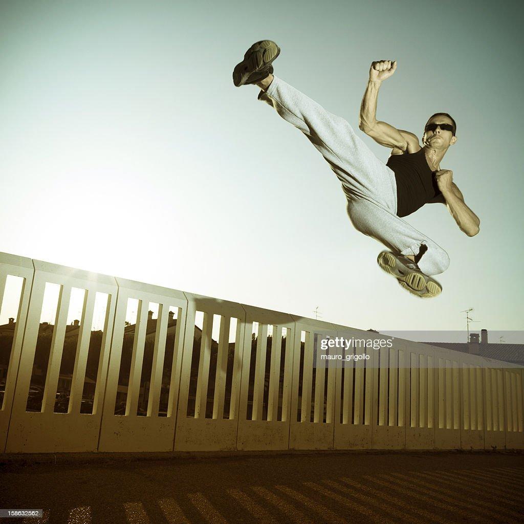Jump fight man : Stock Photo