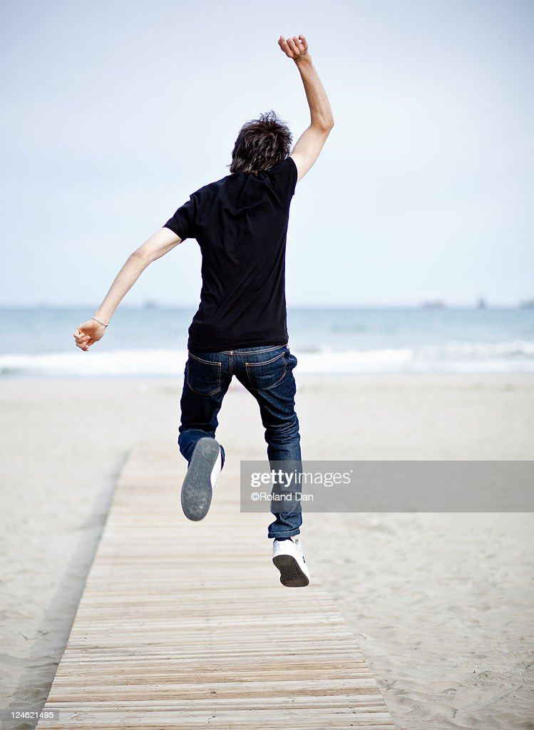 Jump on beach : Stock Photo