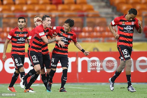 Jumpei Kusukami of the Wanderers celebrates with his team mates after scoring a goal during the round eight ALeague match between the Western Sydney...
