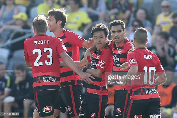 Jumpei Kusukami of the Wanderers celebrates with team mates after scoring a goal during the round nine ALeague match between Central Coast Mariners...