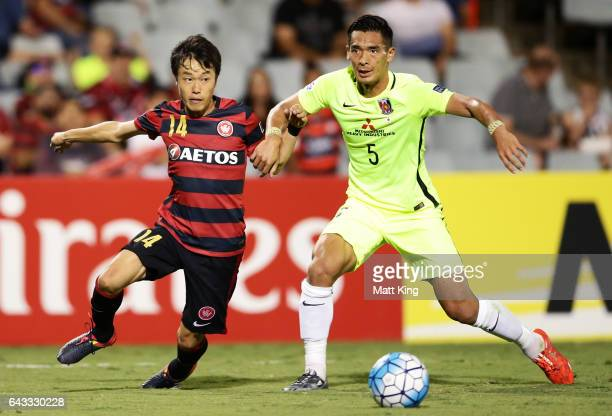 Jumpei Kusukami of the Wanderers competes for the ball against Tomoaki Makino of Urawa Red Diamonds during the AFC Asian Champions League match...