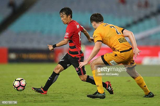 Jumpei Kusukami of the Wanderers is challenged by Alex Grant of the Glory during the round 13 ALeague match between the Western Sydney Wanderers and...