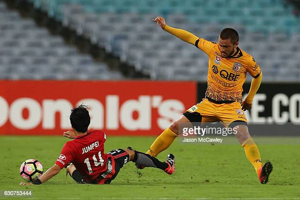 Jumpei Kusukami of the Wanderers is challenged by Josh Risdon of the Glory during the round 13 ALeague match between the Western Sydney Wanderers and...