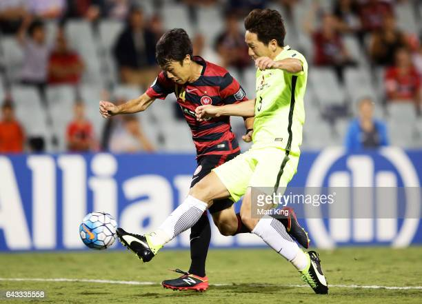 Jumpei Kusukami of the Wanderers is challenged by Tomoya Ugajin of Urawa Red Diamonds during the AFC Asian Champions League match between the Western...