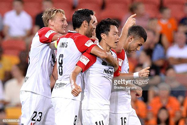 Jumpei Kusukami of the Wanderers is congratulated by team mates after scoring a goal during the round 17 ALeague match between the Brisbane Roar and...