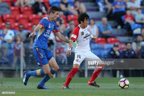 Jumpei Kusukami of the Wanderers is tackled by Jason Hoffman of the Jets during the round 25 ALeague match between the Newcastle Jets and the Western...