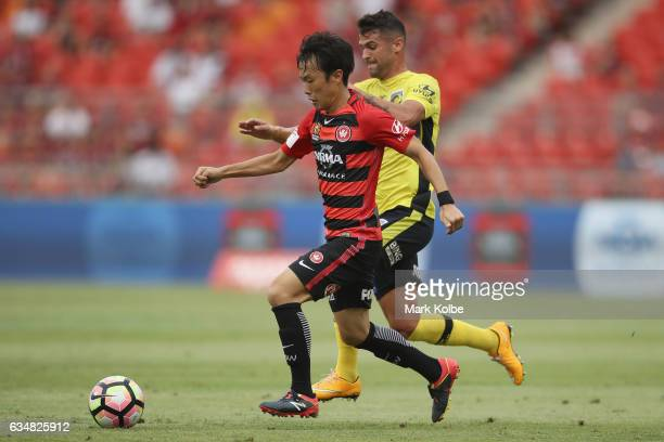 Jumpei Kusukami of the Wanderers takes the ball past Fabio Ferreira of the Mariners during the round 19 ALeague match between the Western Sydney...