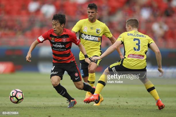 Jumpei Kusukami of the Wanderers takes the ball past Scott Galloway of the Mariners during the round 19 ALeague match between the Western Sydney...