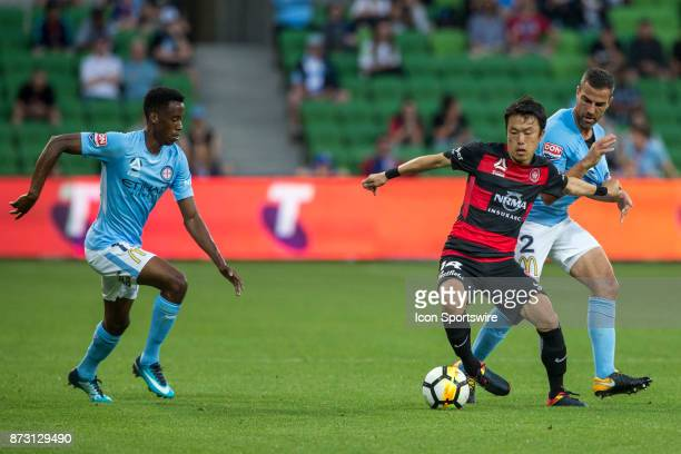 Jumpei Kusukami of the Western Sydney Wanderers Emmanuel Muscat of Melbourne City and Bruce Kamau of Melbourne City contest the ball during Round 6...