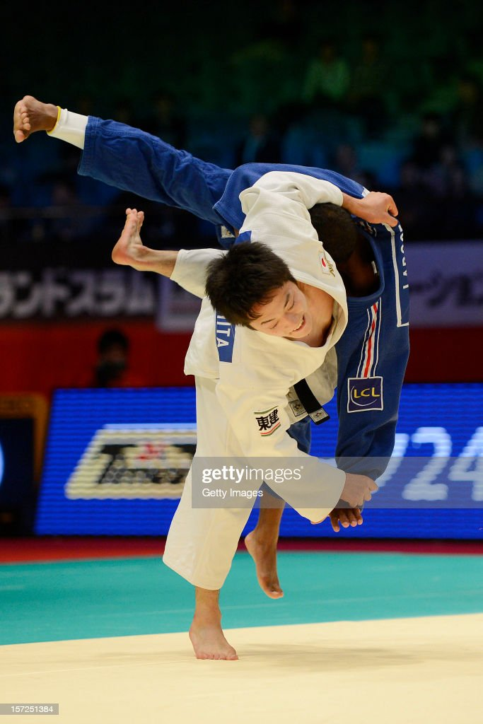 Jumpei Morishita (L) of Japan throws <a gi-track='captionPersonalityLinkClicked' href=/galleries/search?phrase=David+Larose&family=editorial&specificpeople=2255713 ng-click='$event.stopPropagation()'>David Larose</a> of France to win by Ippon in the Men's 66kg final during day one of the Judo Grand Slamat Yoyogi Gymnasium on November 30, 2012 in Tokyo, Japan.