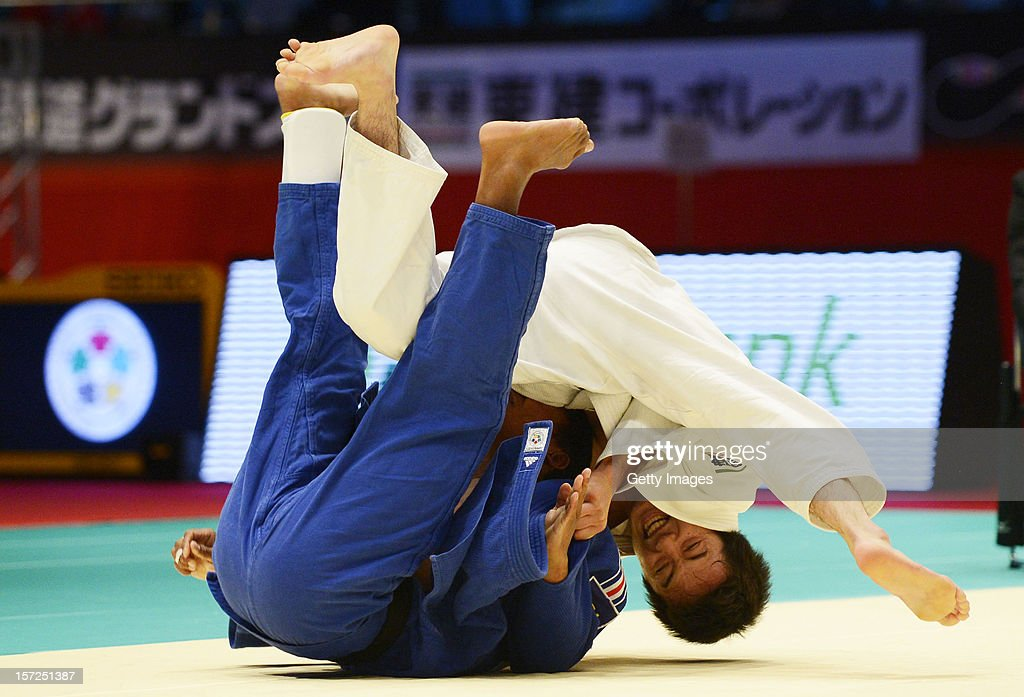 Jumpei Morishita (R) of Japan throws <a gi-track='captionPersonalityLinkClicked' href=/galleries/search?phrase=David+Larose&family=editorial&specificpeople=2255713 ng-click='$event.stopPropagation()'>David Larose</a> of France to win by Ippon in the Men's 66kg final during day one of the Judo Grand Slamat Yoyogi Gymnasium on November 30, 2012 in Tokyo, Japan.