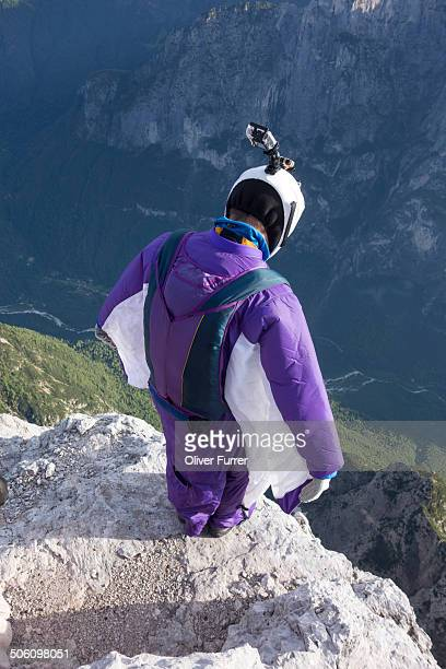 BASE jumper getting ready to jump of the cliff