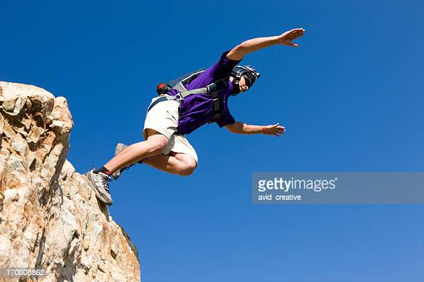 BASE Jumper Jumping Off Cliff