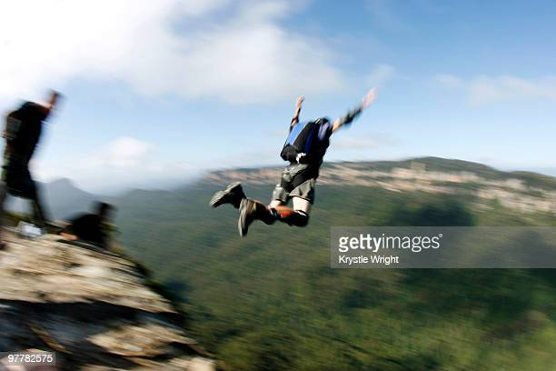 A BASE jumper leaps off a cliff in the Blue Mountains, New South Wales, Australia.