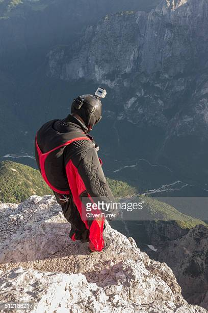 BASE jumper on mountain edge, Alleghe, Dolomites, Italy