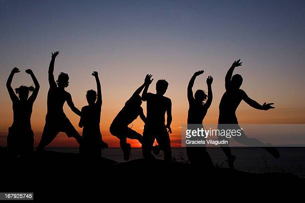 Jumpimg Silhouettes at sunset