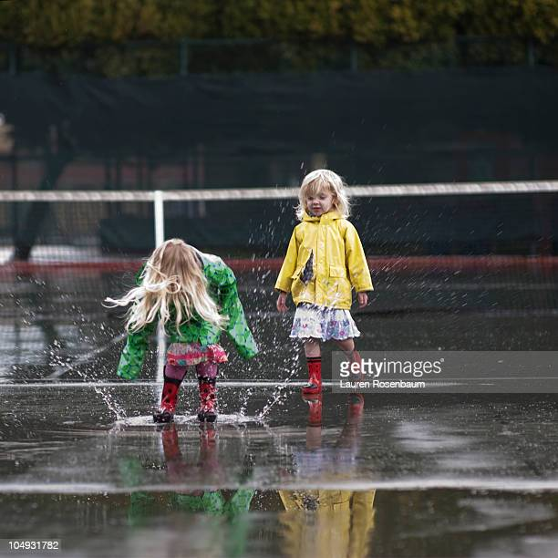 jumpin in the rain in a tennis court