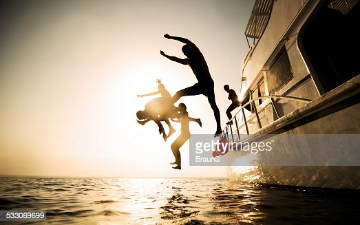 Jumping from the boat at sunset.
