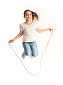 Girl jumping on a skipping rope.