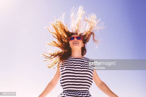 Jumping girl with flying hair