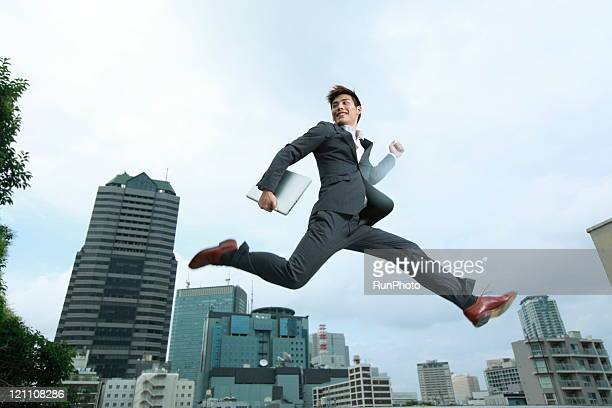 jumping in the air with laptop