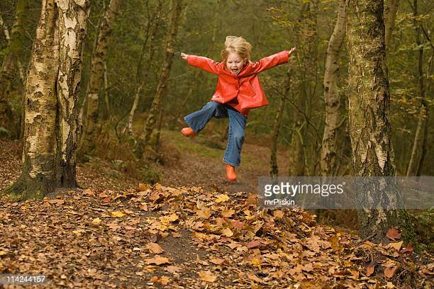 Jumping in the Autumn forest